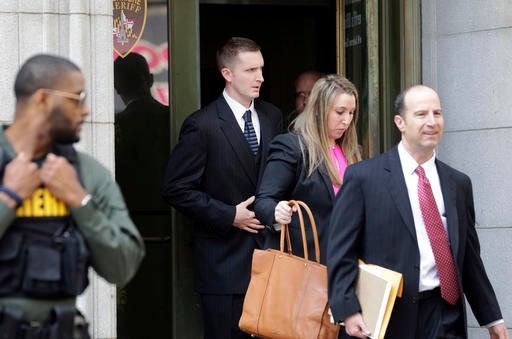 Officer Edward Nero, center, one of six Baltimore city police officers charged in connection to the death of Freddie Gray, leaves a courthouse after being acquitted of all charges in his trial in Baltimore, Monday, May 23, 2016. (AP Photo/Patrick Semansky
