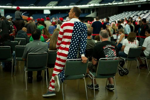 Michael Araujo in a U.S. flag jumpsuit waits for the arrival of Republican presidential candidate Donald Trump at a rally at the Anaheim Convention Center, Wednesday, May 25, 2016, in Anaheim, Calif.
