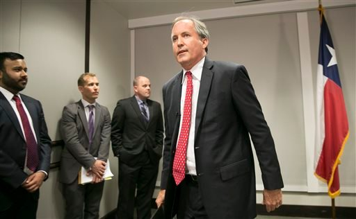 Republican Texas Attorney General Ken Paxton walks away after announcing Texas' lawsuit to challenge President Obama's transgender bathroom order during a news conference in Austin, Texas, Wednesday May 25, 2016. Texas and several other states are suing t