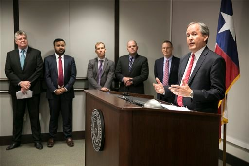 Republican Texas Attorney General Ken Paxton, right, announces Texas' lawsuit to challenge President Obama's transgender bathroom order during a news conference in Austin, Texas, Wednesday May 25, 2016. Texas and several other states are suing the Obama a