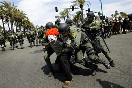 Orange County Sheriff's deputies take a protester into custody outside the Anaheim Convention Center where Republican presidential candidate Donald Trump held a rally, Wednesday, May 25, 2016, in Anaheim, Calif. (AP Photo/Jae C. Hong)