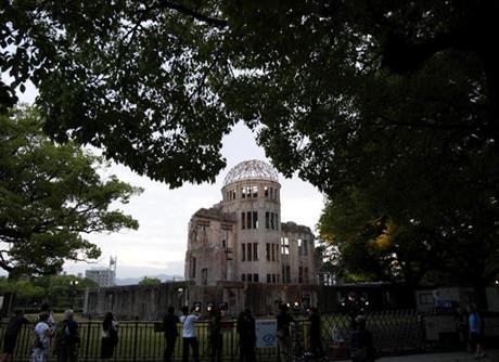 People gather around the gutted Atomic Bomb Dome at the Hiroshima Peace Memorial Park in Hiroshima, southwestern Japan, Thursday, May 26, 2016. (AP Photo/Shuji Kajiyama)