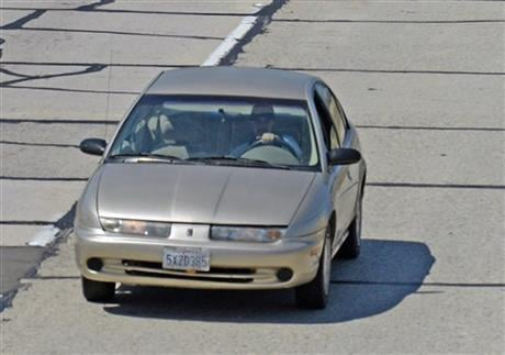 In this photo provided by the Santa Barbara County Fire Department, California Highway Patrol units pursue a car being sought in a statewide Amber Alert in the disappearance of a Northern California 15-year-old girl, as it passes through Buellton on U.S.