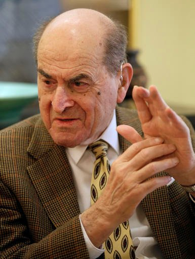 In this Feb. 5, 2014 file photo, Dr. Henry Heimlich describes the maneuver he developed to help clear obstructions from the windpipes of choking victims, while being interviewed at his home in Cincinnati.