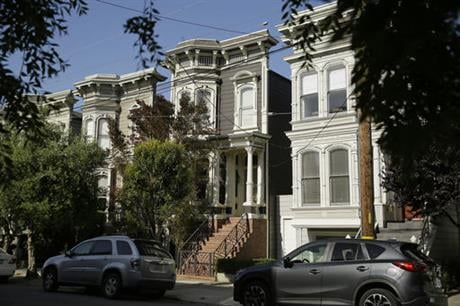 """A Victorian home, center, made famous by the television show """"Full House"""" is seen Friday, May 27, 2016, in San Francisco. The three bedroom home dating from 1883 is now for sale at $4.15 million. (AP Photo/Eric Risberg)"""