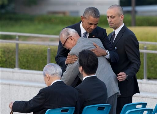 U.S. President Barack Obama hugs Shigeaki Mori, an atomic bomb survivor; creator of the memorial for American WWII POWs killed at Hiroshima, during a ceremony at Hiroshima Peace Memorial Park in Hiroshima, western Japan, Friday, May 27, 2016.
