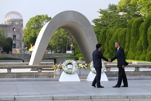 U.S. President Barack Obam, right, and Japanese Prime Minister Shinzo Abe shake hands after laying wreaths at Hiroshima Peace Memorial Park in Hiroshima, western, Japan, Friday, May 27, 2016.