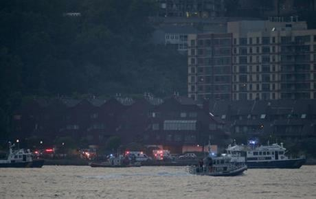 The Federal Aviation Administration say it received a report a World War II vintage P-47 Thunderbolt aircraft may have gone down in the river 2 miles south of the George Washington Bridge. (AP Photo/Julie Jacobson)