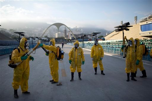 In this Tuesday, Jan. 26, 2016 file photo, health workers get ready to spray insecticide to combat the Aedes aegypti mosquitoes that transmits the Zika virus.
