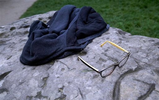 A child's glasses and a jacket lie on a rock in the Park Monceau, after a lightning strike in Paris, Saturday, May 28, 2016.