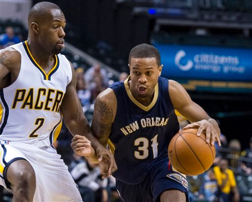 In this Oct. 3, 2015, file photo, New Orleans Pelicans' Bryce Dejean-Jones (31) drives the ball around the defense of Indiana Pacers' Rodney Stuckey (2) during the first half of a preseason NBA basketball game in Indianapolis.