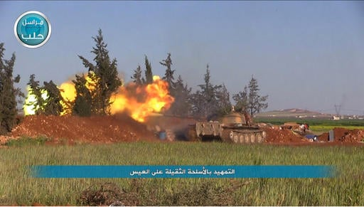 This file image posted on the Twitter page of Syria's al-Qaida-linked Nusra Front on Friday, April 1, 2016, shows Nusra Front tank fires at Syrian troops and pro-government gunmen in the northern village of al-Ais in Aleppo province, Syria. Al-Qaida's br