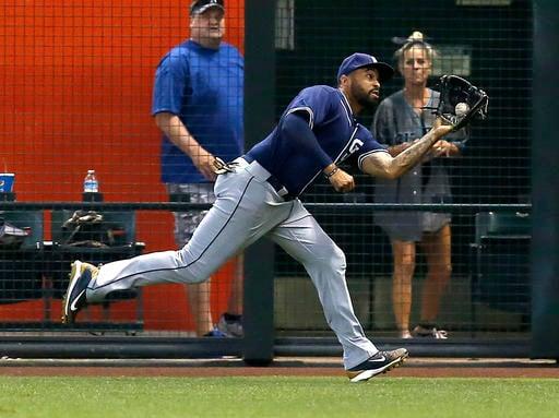 San Diego Padres right fielder Matt Kemp makes the running catch against the /Arizona Diamondbacks in the seventh inning during a baseball game, Sunday, May 29, 2016, in Phoenix. (AP Photo/Rick Scuteri)