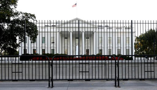 In this Sept. 22, 2014, file photo, The White House is viewed from Pennsylvania Avenue in Washington. Republicans and Democrats feel a massive disconnect with their political parties and report an overwhelming feeling of helplessness heading into the nex