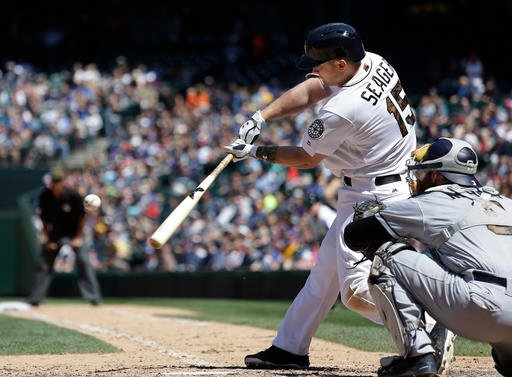 Seattle Mariners' Kyle Seager hits a two-run home run as San Diego Padres catcher Derek Norris looks on in the sixth inning of a baseball game Monday, May 30, 2016, in Seattle. (AP Photo/Elaine Thompson)