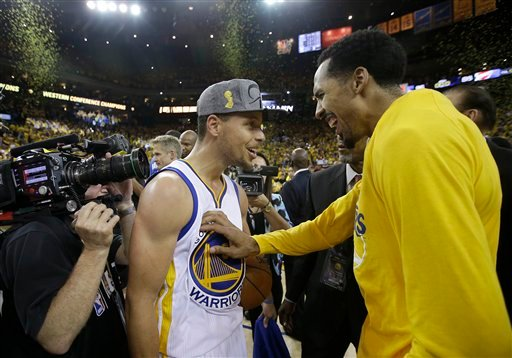 Golden State Warriors guard Stephen Curry, left, and guard Shaun Livingston celebrate after the Warriors beat the Oklahoma City Thunder in Game 7 of the NBA basketball Western Conference finals in Oakland, Calif., Monday, May 30, 2016.