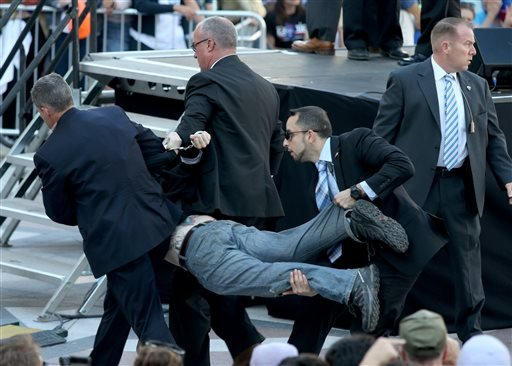 Secret Service agents remove a man from the crowd during a campaign rally for Democratic presidential candidate, Sen. Bernie Sanders, I-Vt., at Frank Ogawa Plaza in Oakland, Calif., on Monday, May 30, 2016.