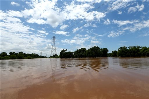 The Brazos River has exceeded its banks and is flooding nearby properties Sunday, May 29, 2016, in Rosenberg, Texas.