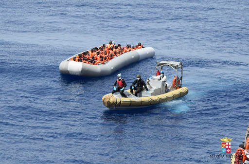 This undated image made available Monday, May 30, 2016 by the Italian Navy Marina Militare shows migrants being rescued at sea.