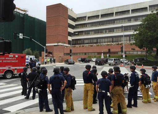 Los Angeles fire department personnel gather at the scene of a fatal shooting at the University of California, Los Angeles, Wednesday, June 1, 2016, in Los Angeles. (AP Photo/Ringo H.W. Chiu)
