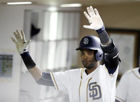 San Diego Padres' Alexei Ramirez looks to high-five teammates in the dugout, but is ignored, after hitting his second two-run home run of the baseball game against the Seattle Mariners, during the sixth inning Wednesday, June 1, 2016. (AP Photo/Alex Galla