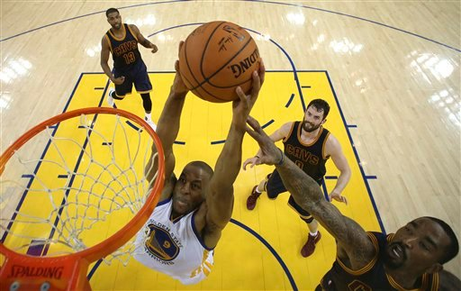 Golden State Warriors forward Andre Iguodala (9) dunks against the Cleveland Cavaliers during the first half of Game 2 of basketball's NBA Finals in Oakland, Calif., Thursday, June 2, 2016. (Ezra Shaw, Getty Images via AP, Pool)