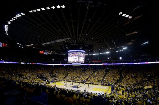 Fans at Oracle Arena watch during the first half of Game 1 of basketball's NBA Finals between the Golden State Warriors and the Cleveland Cavaliers in Oakland, Calif., Thursday, June 2, 2016. (AP Photo/Marcio Jose Sanchez)