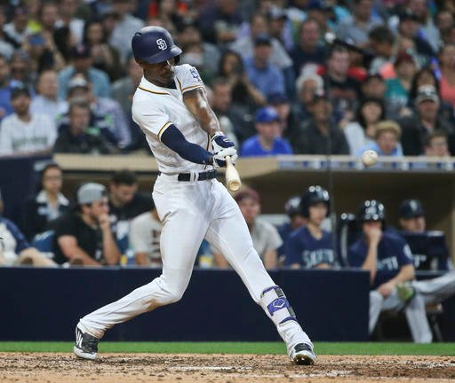 San Diego Padres' Melvin Upton Jr. connects to drive in two runs in the Padres' seven-run fifth inning in a baseball game against the Seattle Mariners on Thursday, June 2, 2016, in San Diego.. (AP Photo/Lenny Ignelzi)