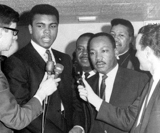 In this March 29, 1967, file photo, heavyweight champion Muhammad Ali, center left, and Dr. Martin Luther King speak to reporters.