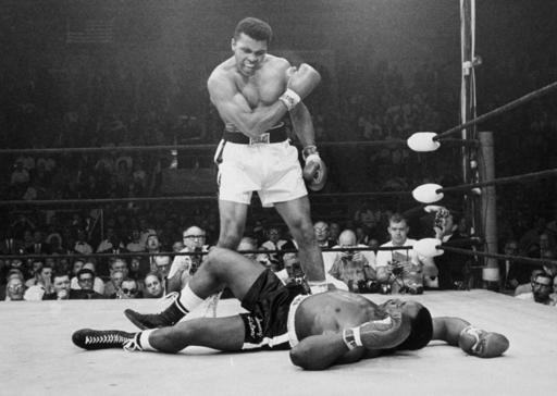 In this May 25, 1965, file photo, heavyweight champion Muhammad Ali, then known as Cassius Clay, stands over challenger Sonny Liston.