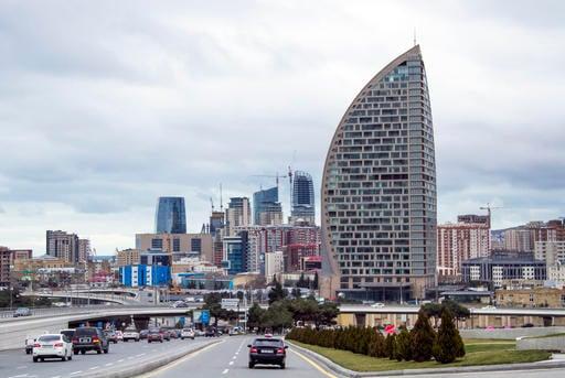 In this Feb. 19, 2016, file photo, The Trump International Hotel, the highest building, is seen in Baku, Azerbaijan.