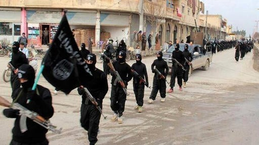 This undated file image posted on a militant website on Tuesday, Jan. 14, 2014, which has been verified and is consistent with other AP reporting, shows fighters from the al-Qaida linked Islamic State of Iraq and the Levant (ISIL), now called the Islamic