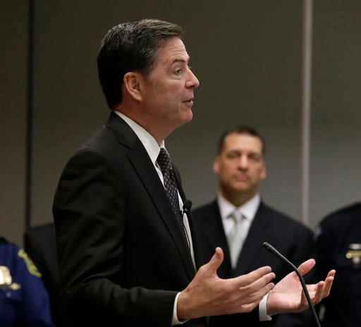 in this April 5, 2016, file photo, FBI Director James Comey addresses the media after visiting with employees and other law enforcement officials in Detroit. Violent crimes ranging from homicides to rapes to robberies have been on the rise in many major U