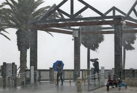 A large portion of Florida's western and Panhandle coast was already under a tropical storm warning when the National Hurricane Center announced that a swift-moving depression had become a named storm. (AP Photo/Chris O'Meara)