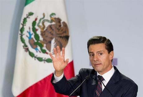 On the same day that Pena Nieto spoke at the forum, the international program Open Society Justice Initiative released a report saying the Mexican government has committed crimes against humanity in its war against drug cartels. (AP Photo/Rebecca Blackwel