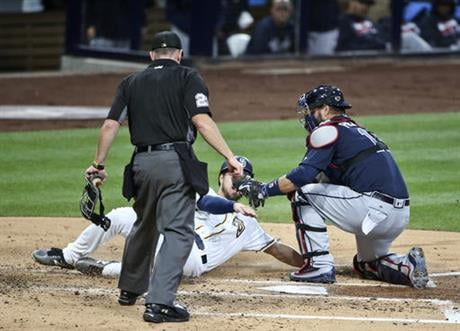 Atlanta Braves catcher A.J. Pierzynski tags out San Diego Padres' Colin Rea at home during the second inning of a baseball game Tuesday, June 7, 2016, in San Diego. (AP Photo/Lenny Ignelzi)
