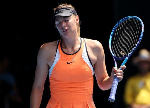 In this Tuesday, Jan. 26, 2016 file photo, Maria Sharapova of Russia reacts after losing a point to Serena Williams of the United States during their quarterfinal match at the Australian Open tennis championships in Melbourne, Australia.