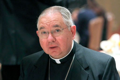 In this Jan. 14, 2014 file photo, Los Angeles Archbishop Jose Gomez makes the keynote speech at a Town Hall Los Angeles forum in Los Angeles. Largely Latino California has become the first majority-minority state to allow the terminally ill to hasten the