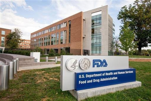 This Oct. 14, 2015, file photo, shows the Food & Drug Administration campus in Silver Spring, Md. Despite new legal powers to compel recalls and sophisticated technology to fingerprint pathogens, the Food and Drug Administration allowed some food-safety i