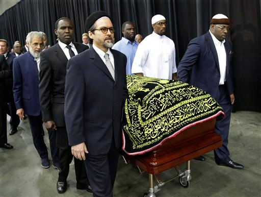 Muhammad Ali's casket is escorted by pallbearers for his Jenazah, a traditional Islamic Muslim service, in Freedom Hall, Thursday, June 9, 2016, in Louisville, Ky. (AP Photo/David Goldman)