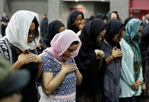 Women pray during Muhammad Ali's Jenazah, a traditional Islamic Muslim service, in Freedom Hall, Thursday, June 9, 2016, in Louisville, Ky. (AP Photo/David Goldman)