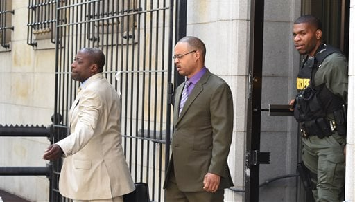 Baltimore Police Officer Caesar Goodson, center, leaves Courthouse East with his lawyer Matthew Fraling on Monday, June 6, 2016, in Baltimore. Caesar Goodson, who was driving the transport wagon, faces second-degree murder, manslaughter, assault, miscondu