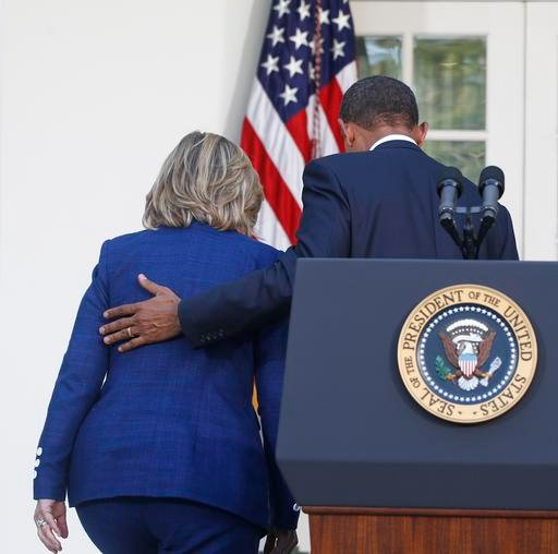In this photo taken Sept. 1, 2010, President Barack Obama walks with then-Secretary of State Hillary Rodham Clinton after he made a statement in the Rose Garden of the White House in Washington.