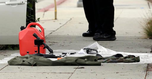 Items removed from a car are displayed on a sidewalk after a heavily armed man was arrested in Santa Monica, Calif., early Sunday, June 12, 2016. The man reportedly told police he was in the area for West Hollywood's huge gay pride parade. Authorities did