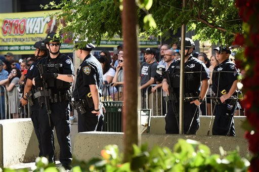 Police officers stand guard outside the Tony Awards at the Beacon Theatre on Sunday, June 12, 2016, in New York. (Photo by Charles Sykes/Invision/AP)