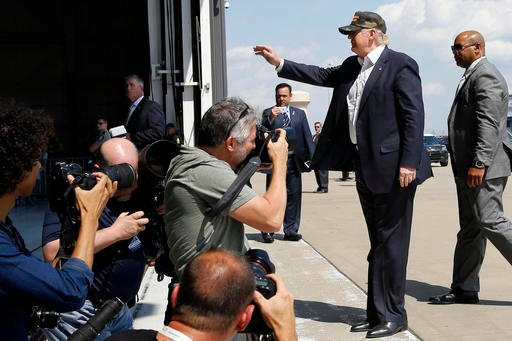 Republican presidential candidate Donald Trump waves to the crowd as he is photographed arriving to speak at a campaign rally, Saturday, June 11, 2016 at a private hanger at Greater Pittsburgh International Airport in Moon, Pa. (AP Photo/Keith Srakocic)