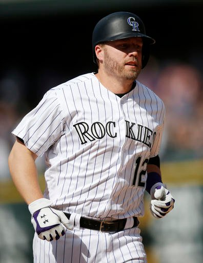 Colorado Rockies' Mark Reynolds circles the bases after hitting a solo home run off San Diego Padres relief pitcher Kevin Quackenbush in the seventh inning of a baseball game Sunday, June 12, 2016, in Denver. (AP Photo/David Zalubowski)