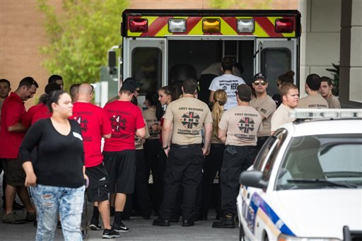 EMS first response personnel are seen outside a Hampton Inn & Suites hotel, which turned into a hub for families and friends waiting to hear about loved ones because of its proximity to the Orlando Regional Medical Center, in the wake of a mass shooting t