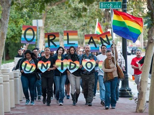 Several hundred supporters, led by Laura Kanter, at right, marched to Sasscer Park after a vigil at Calle Cuatro Plaza in support of the Orlando shooting victims Sunday, June 12, 2016, in Santa Ana, Calif. (Kevin Sullivan/The Orange County Register via AP