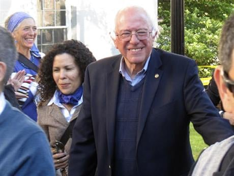 Democratic presidential candidate Sen. Bernie Sanders, I-Vt., arrives at City Hall Park in Burlington, Vt., on Monday, June 13, 2016. Sanders took park during a march and vigil for the people killed and wounded during a shooting at an Orlando, nightclub.